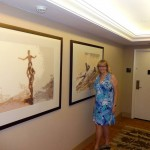 Marti next to her retro series art in Waikiki Hilton Tower